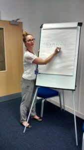 Claire Roberts writing on a flip chart