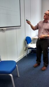 pointing at whiteboard