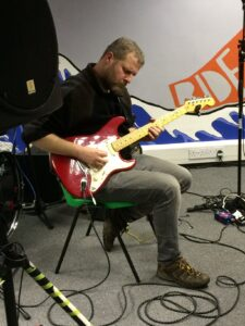 Volunteer on electric guitar