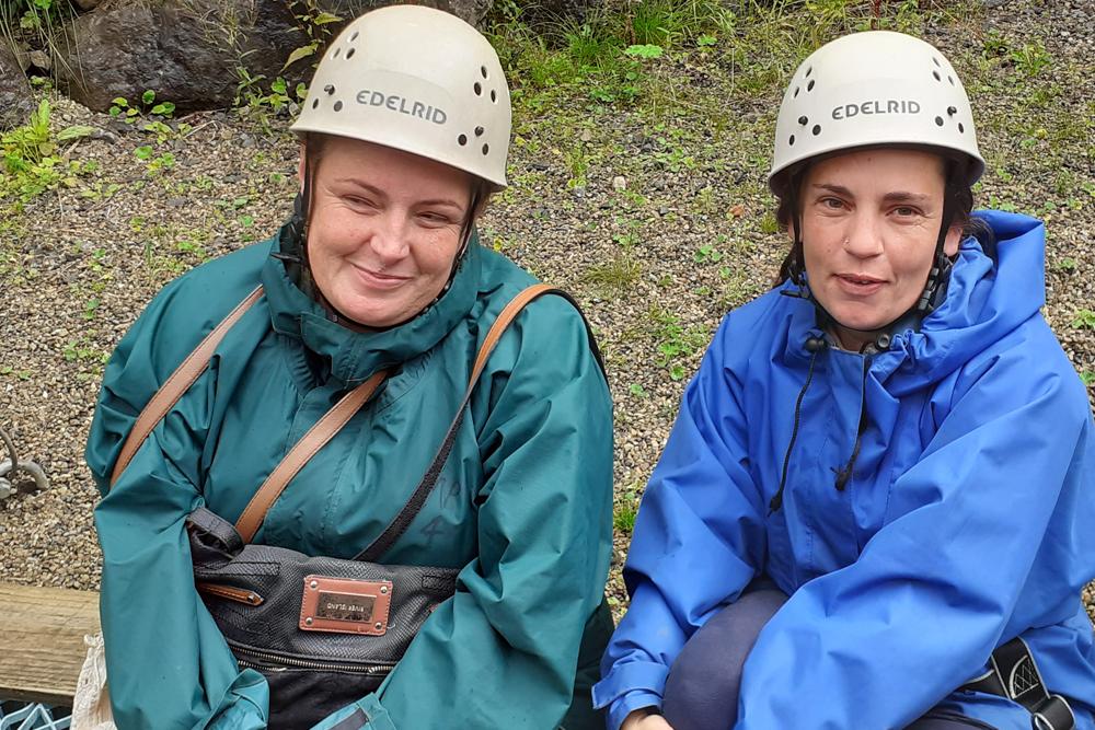 two women in helmets