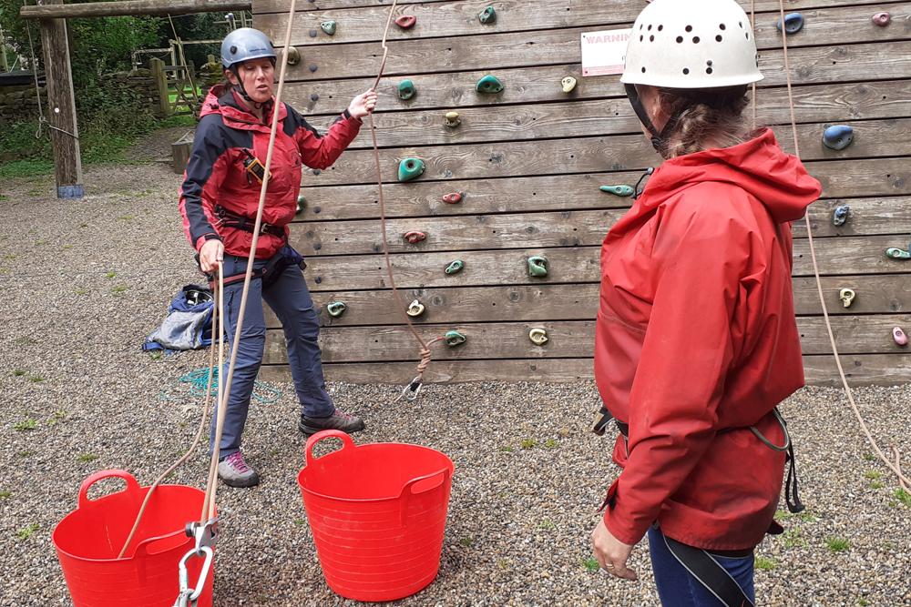 women tackling a climbing wall